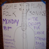 Handmade sign inviting other musicians to play folk songs with The Cyclops for Labor String Band on Monday at 8pm in the basement cafeteria.